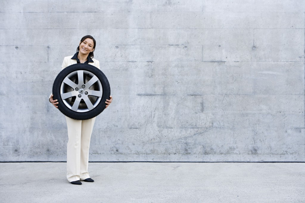 Woman holds tyre