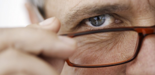 man looking over glasses