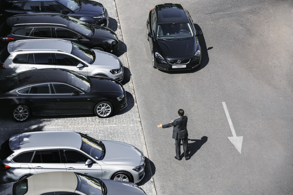 Man directing person into parking space