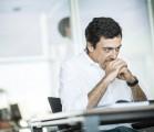 Man sat at desk thinking
