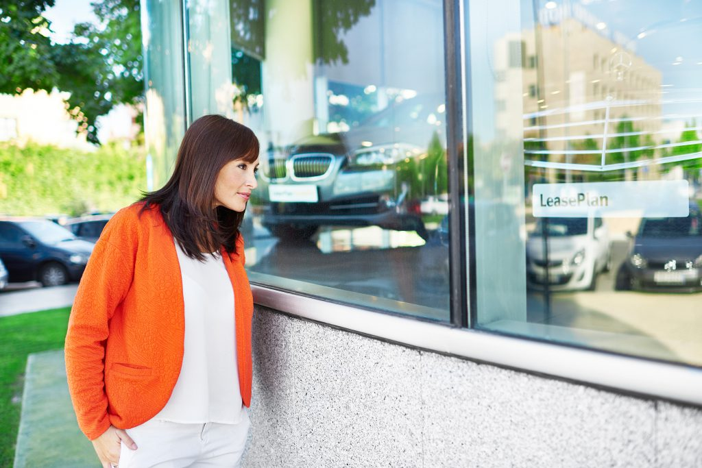 woman looking in dealership window
