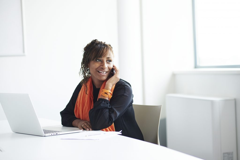Woman at desk with leaseplan orange scarf