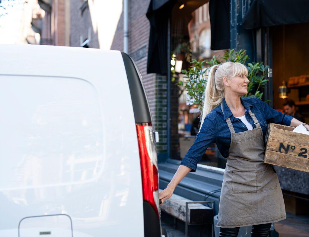 Woman unloading a van
