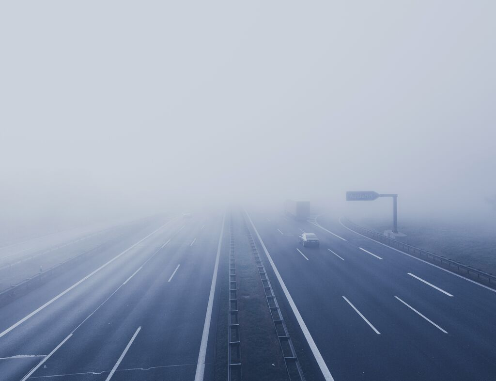 Misty motorway at dusk